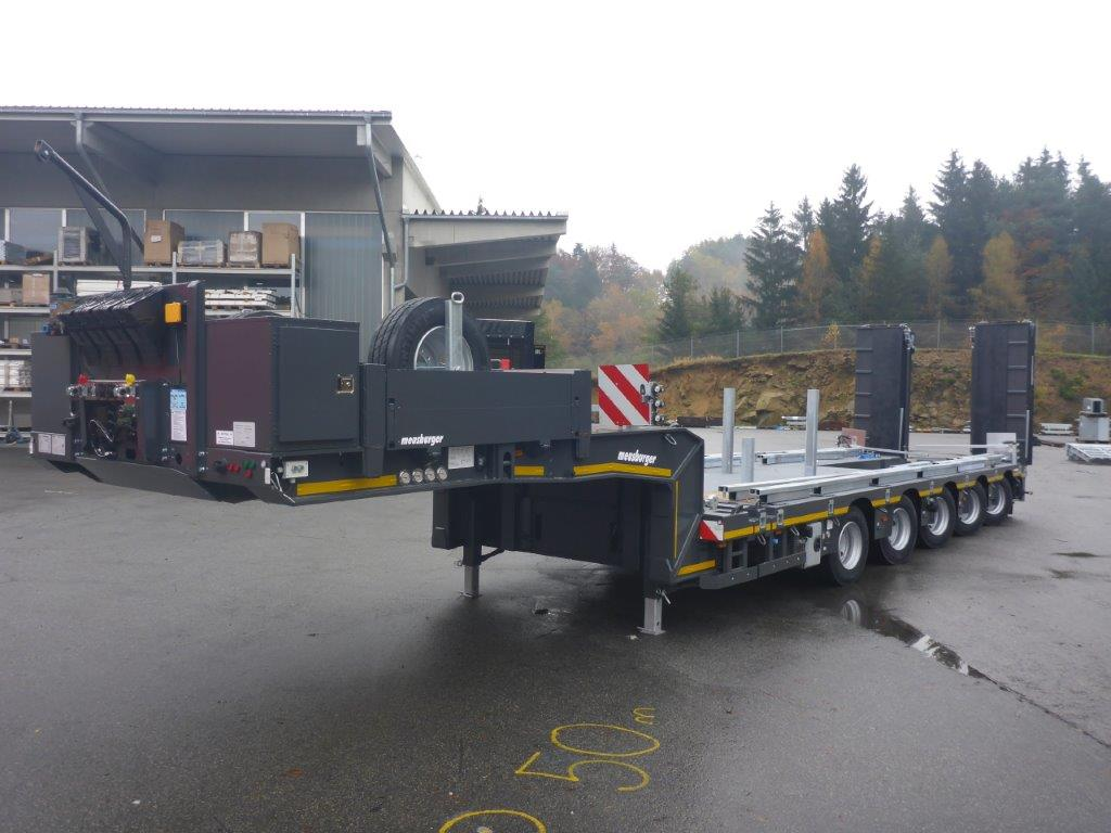 Meusburger 5-axle-tele-semi-trailer with half axles and hydraulic ramps